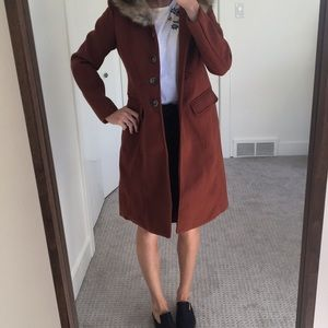 Rust colored coat with faux fur hood